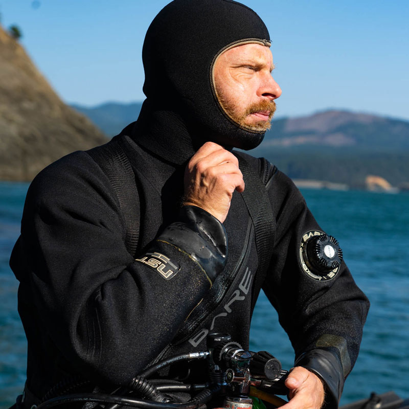 Doctor Aaron Galloway preparing for an urchin survey dive in Port Orford, Oregon