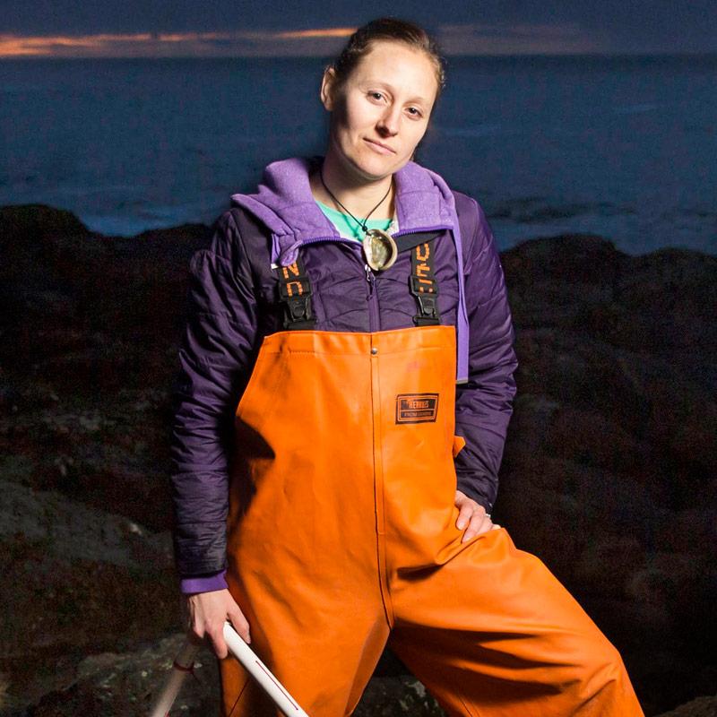 Doctor Sarah Gravem posing on a beach at night