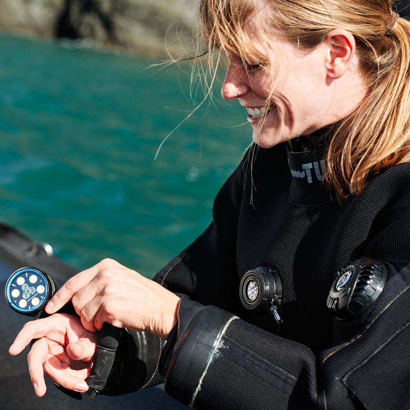 Sara Hamilton checking her scuba gear before a dive